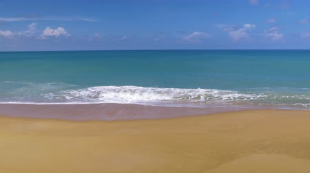 dalgalı : Beautiful blue ocean on sandy beach background with motion scene at Phuket, Thailand Stok Video