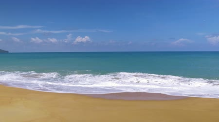 Beautiful blue ocean on sandy beach background with motion scene at Phuket, Thailand Stock Footage