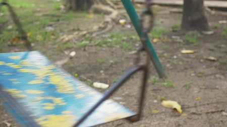 Steel swing in the playground wobbles back and forth. Stock Footage