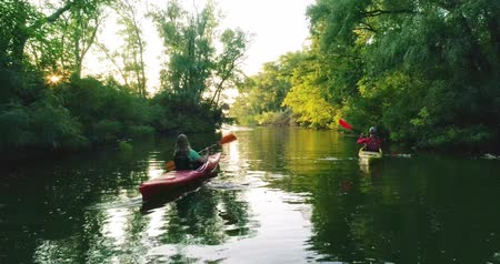 Two kayaks with people on the scenic river