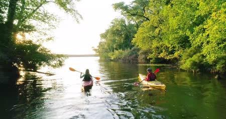 kayak : Two kayaks with people on the scenic river