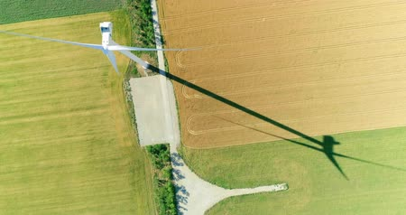 Windmill for electric power production in the agricultural fields. View from above. Stok Video