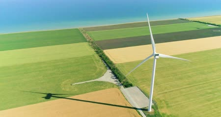 Windmill for electric power production in the agricultural fields. Aerial view. Stok Video