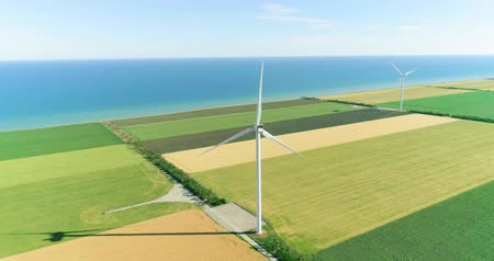 Group of windmills for electric power production in the agricultural fields. Aerial view. Stok Video