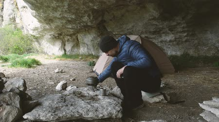 wilderness : Traveler with a smartphone in the grotto