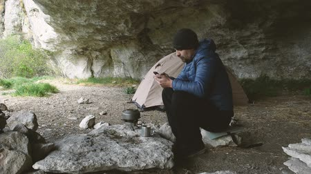 Traveler with a smartphone in the grotto