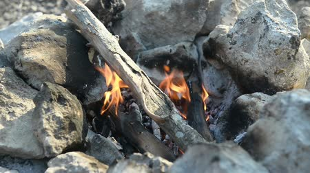 Bonfire in a camp-fire of stones outdoors