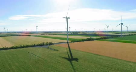 Group of windmills for electric power production in the agricultural fields Dostupné videozáznamy