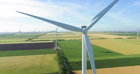 Group of windmills for electric power production in the agricultural fields. Dostupné videozáznamy