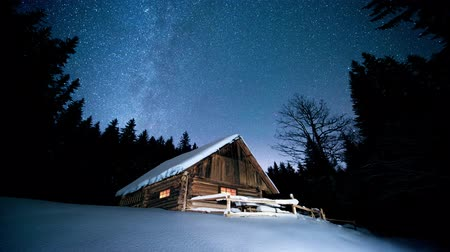 Time-lapse. Beautiful wooden house in the winter forest