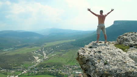 happy young man on the mountain