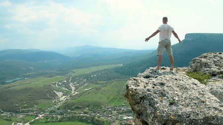 ambition : happy young man on the mountain