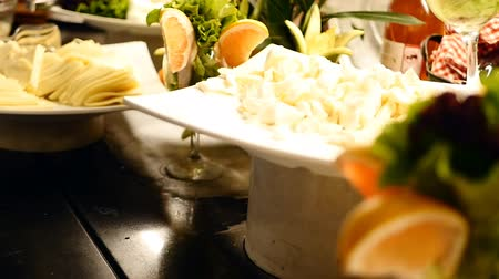 буфет : Variety of tasty delicious cheeses in a hotel buffet in slow motion