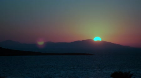 rhodes : Timelapse of beautiful sunset behind the Mediterranean sea and mountains. in Turkey and Greece islands.