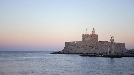 rhodes : Timelapse on the sea and the entrance to the harbor in Rhodes greece Stock Footage