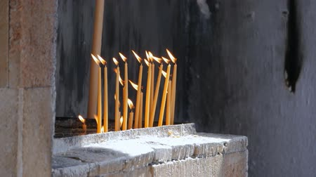 rhodes : Candles Are Lit in the Foreground, outdoors. St. Annas Church in Rhodes, Greece
