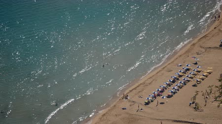 rhodes : Sand beach from aerial top view. Tourists relaxing, umbrellas and deck chairs on the beach. Rhodes beach.