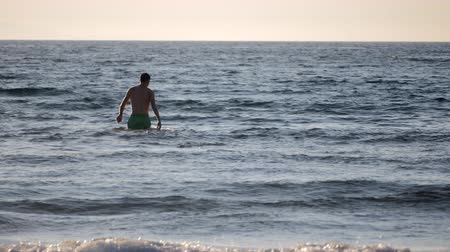 rhodes : Young man is going to swim in the sea but it is not getting deeper. Fast motion Stock Footage