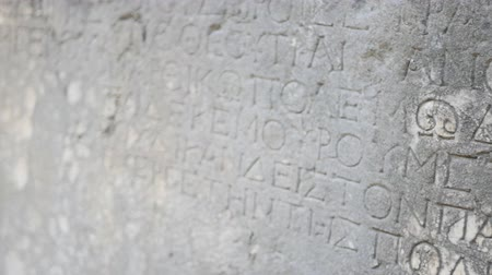 phaselis : Ancient Greek script carved on stone plate, Phaselis,Turkey Stock Footage