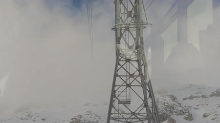 vago : View from a cabin to a cable car tower appearing from the fog. Winter time