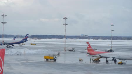 takeoff area : MOSCOW, RUSSIA - DECEMBER 24, 2017: Timelapse at Domodedovo airport seen planes and take-off area, passing vehicles.
