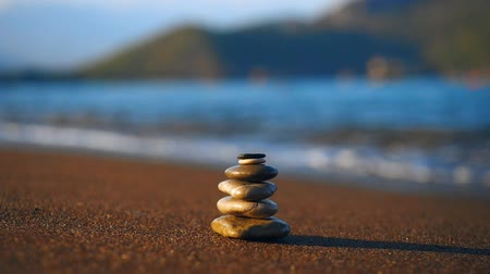 hierarchy : Pile of stones on sand beach