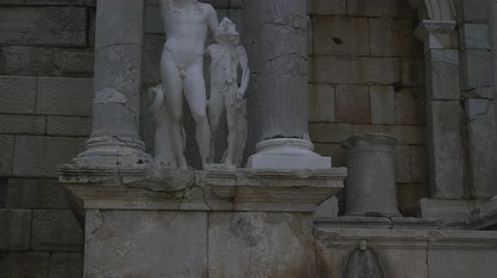 dionysus : View of Dionysus sculpture in Antonine Nymphaeum and Upper Agora in Sagalassos ancient city in Burdur, Turkey in autumn cloudy time Stock Footage