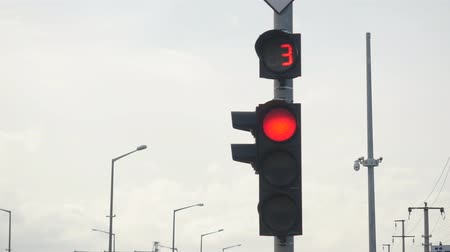 stoplight : closeup of red traffic light with numbers counting down, then yellow and starts green light Stock Footage