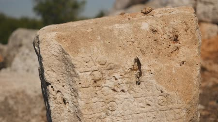 taş işçiliği : Ancient stone with carving in Lyrboton Kome ancient city, Turkey Stok Video