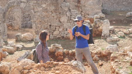 Two young and enthusiastic archaeologists exploring ancient city