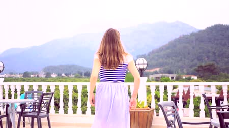 招待状 : Happy beautiful woman excited on the beautiful view on the terrace