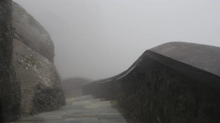 kalambaka : Varlaam monastery stairs in rainy foggy day at Meteora Greece. Low visibility