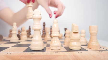 hierarchy : Womans hand setting up white chess figures on the board Stock Footage
