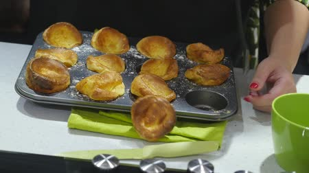 ón : Taking homemade cheese muffins out of muffin tray with spatula Stock mozgókép