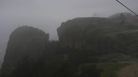 kalambaka : Panoramic view of Holy Trinity, Meteora in Greece in winter foggy rainy day Stock Footage