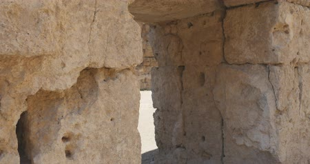 antichita : Camera moving through ancient arch in the wallin Ancient city Perge with antique temple ruins of ancient temple roman architecture on background. This is open air antique historical museum in Turkey