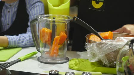 harmanlanmış : Closeup of making smoothie of baked pumpkin and apple juice in blender