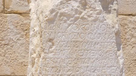 taş işçiliği : Ancient Greek writing chiseled on white stone. Patara Turkey