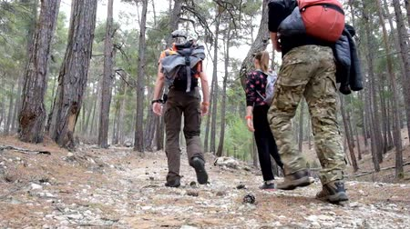 šplhání : Hikers walking to the Tahtali mountain peak in Turkey, Antalya province wearing hiker backpacks. Tahtali mountain is 2365m high.