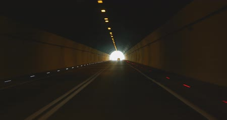 tunel : Car driving through dark tunnel. Highway tunnel at day time