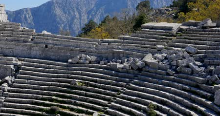 以上 : Young woman in amphitheater in Pisidian city Thermessos built at an altitude of more than 1000 metres near Antalya in Turkey.