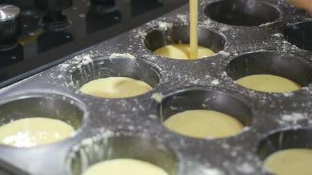 ón : Making homemade cheese muffins, pouring dough to muffin tray Stock mozgókép