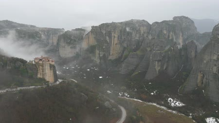 kalambaka : Panoramic view of Roussanou Monastery, Meteora in Greece in winter foggy day, fast motion Stock Footage