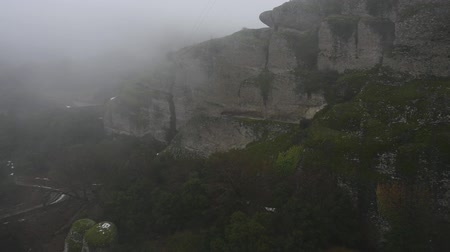 kalambaka : Winter Meteora Greece view from Holy Trinity monastery in rainy weather Stock Footage