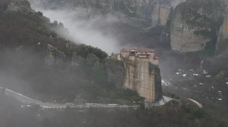 kalambaka : Panoramic view of Roussanou Monastery, Meteora in Greece in winter foggy day,