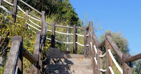 wooden bridge : Outdoor wooden stair going up the hill