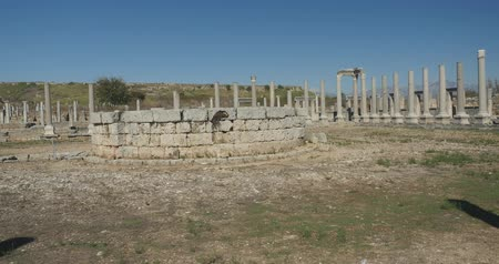 amphitheatre : Panoramic view of Ancient city Perge with antique temple ruins of ancient temple roman architecture on background. This is open air antique historical museum in Turkey Stock Footage