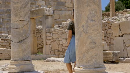 antikvitás : Woman tourist walking in colonnaded street of ancient greek agora in Patara, Turkey