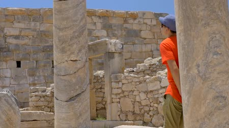 antikvitás : Man tourist walking in colonnaded street of ancient greek agora in Patara, Turkey