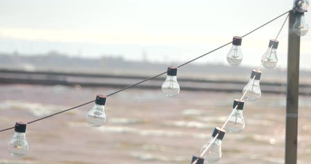 banquete : Beautiful decore in cafe of light bulbs garland near the sea